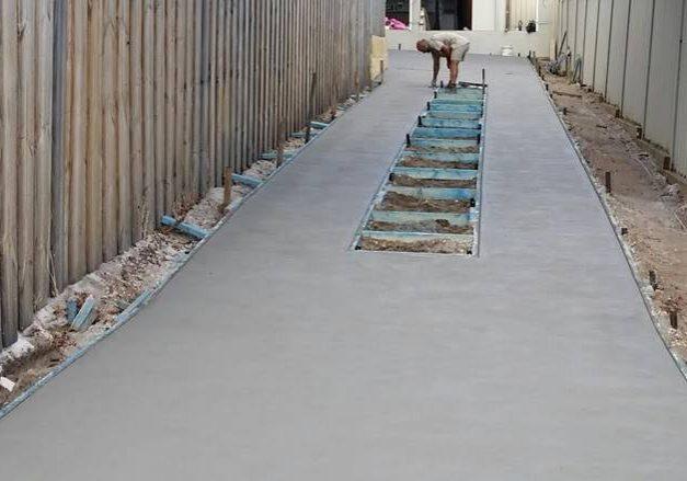 long concrete driveway for rear home.